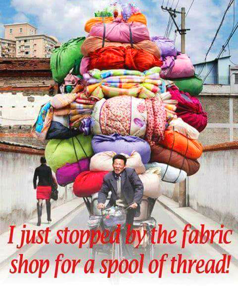piled up with fabrics
